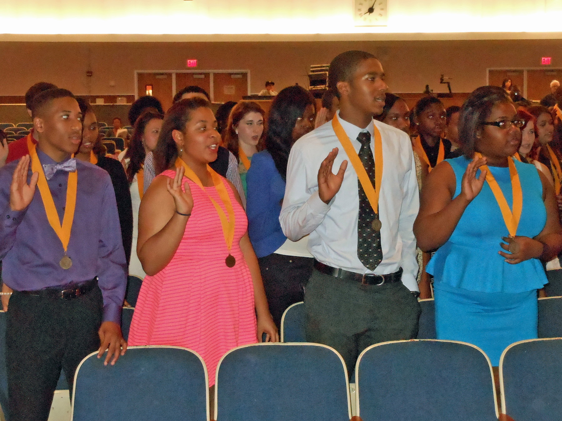 SMART STUDENTS: Several FHS National Honor Society inductees take their oath.