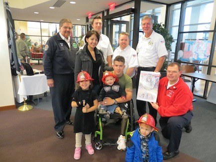 Pictured from from last year's trip is Marine Marcus Dandrea and his family with members of the LFD.