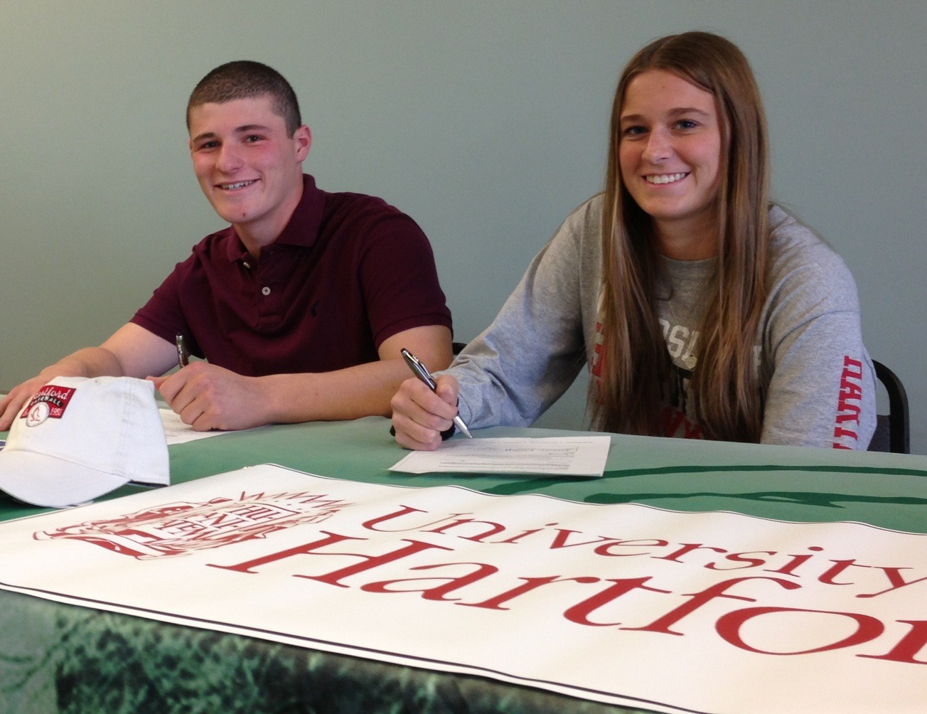 Justin Ganca and Lauren Sustad have signed with the University of Hartford to play baseball and softball. Above, the two signing their national letters of intent recently at Kennedy.