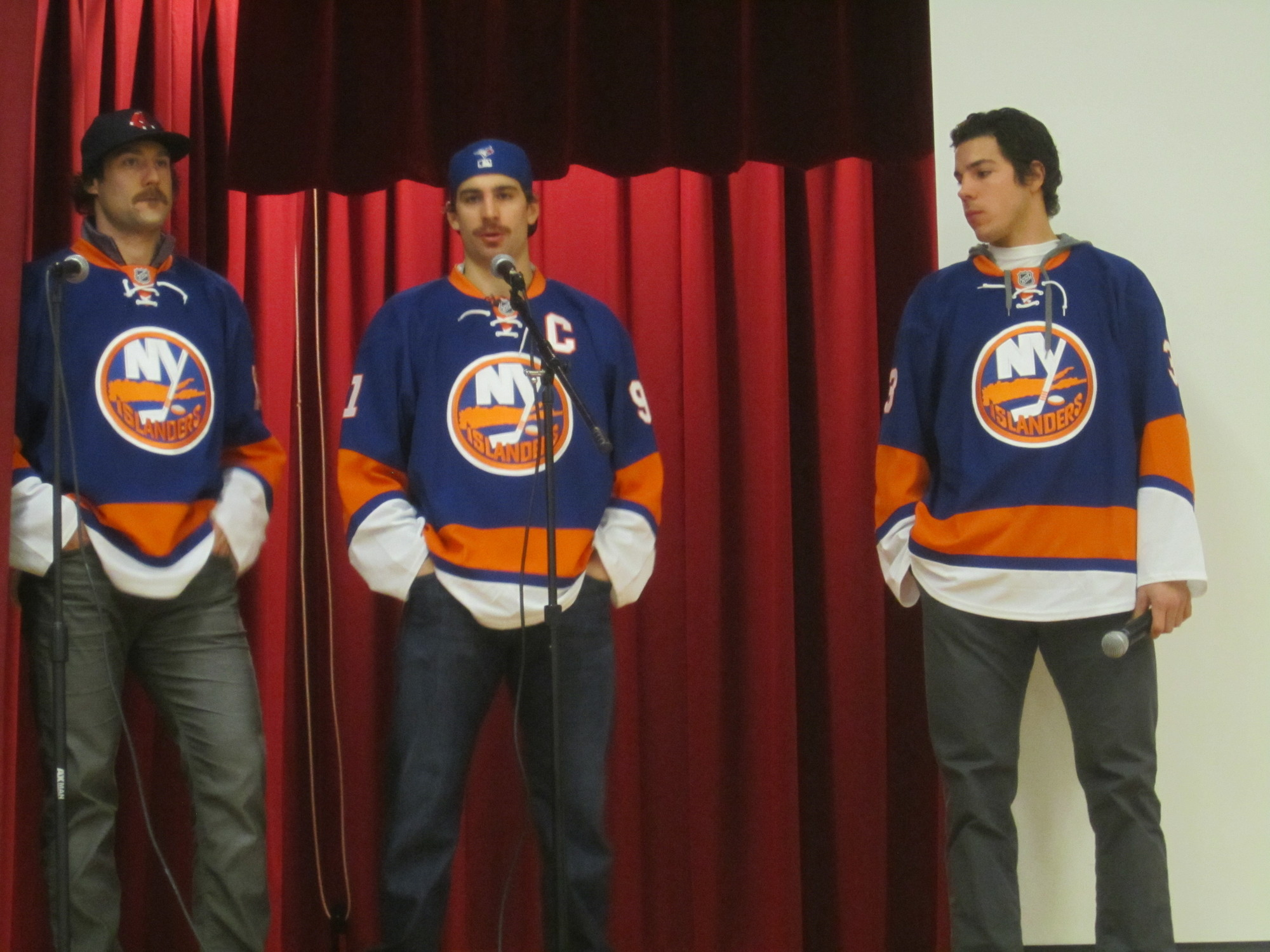 Colin McDonald, 29, a New York Islanders right wing, John Tavares, 23, an Islanders center and the team's captain, and Travis Hamonic, 23, an Islanders defenseman, addressed students on Tuesday at Fayette Elementary School in North Merrick, stressing the importance of education, hard work and teamwork.