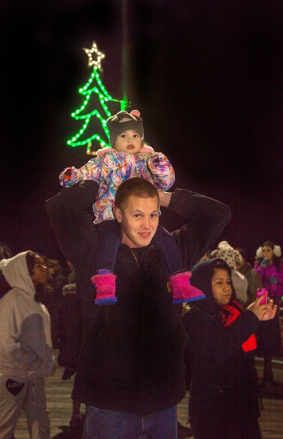 Chris Quinn and his daughter, Leah, 2, checked out the new holiday lights on the boardwalk at a ceremony on Monday.