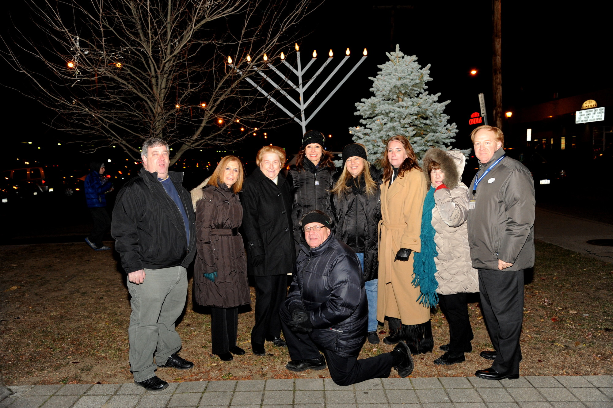 Merrick Chamber of Commerce directors and officers Ira Reiter, Louise Pitlake, Marian Fraker, Randy Shotland, Margaret Biegelman, Lisa Deturris, Margaret Muller, Elaine Spiro and Seth Pitlake braved the cold as they unveiled the chamber's giant menorah in downtown Merrick shortly before the start of Hanukkah.