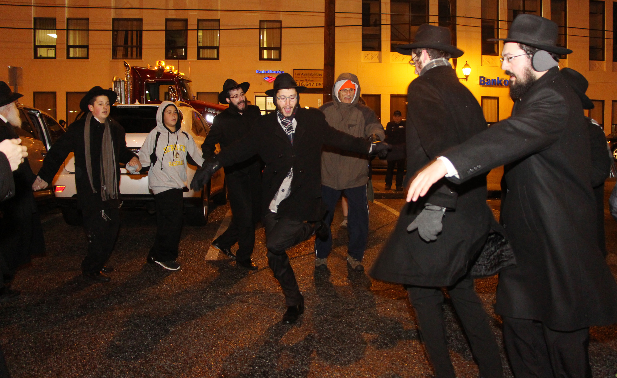 Hanukkah celebrants danced in a circle during a Chabad of Merrick/Bellmore/Wantagh parade on Nov. 27 at Veterans Broadcast Plaza in downtown Merrick.
