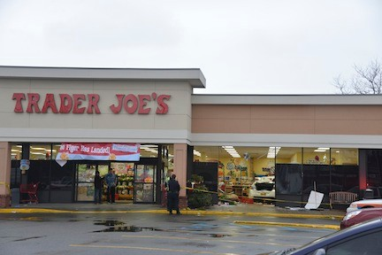 "A white Buick sat near the checkout counters inside Trader Joe's in Oceanside on the afternoon of Dec. 6, after an elderly woman driver, who Oceanside Fire Department sources said was ""disoriented,"" plowed into the store."