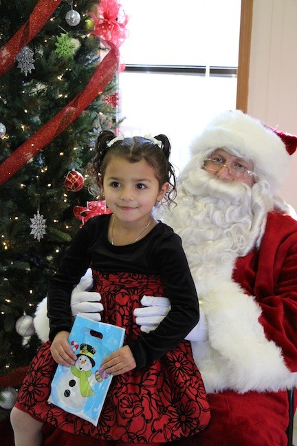 Gabriella Battaglia, 4, sat on Santa�s lap, as she told him what she wanted for Christmas.