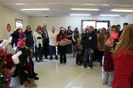 Island Park�s town hall was full of excited children and their parent, waiting to see Santa. The children had their lists and the parents their cameras, as everybody�s smiles were ready for the big moment when they met Santa Claus.