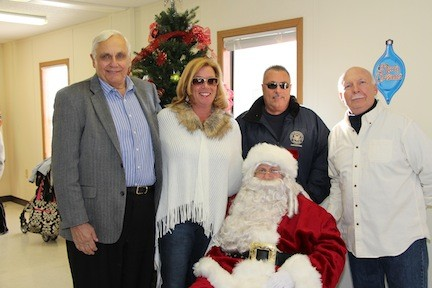 Santa is visited by Island Park�s Village officials, including trustees Henry Hastava and Irene Naudus, as well as Mayor James Ruzicka.