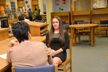 Principal Geraldine DeCarlo interviews Paige McMann at career day in the Oceanside High School library on Nov. 6.