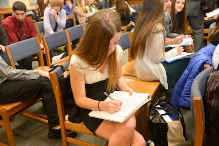 Amanda Andersen fills out her resume before the interview. Andersen wants to study to be a nurse.
