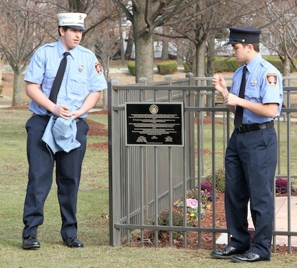 Valley Stream Junior Fire Department members Capt. Richie Field, left, and Neil Aliventi unveiled the new plaque at the village's Sept. 11 memorial.