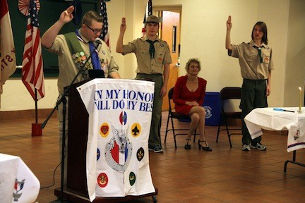 Eagle Scout Richard Capo, left, led Jack and Charlie Clifford in the Eagle Scout Promise at the their Court of Honor ceremony on Dec. 1 at Blessed Sacrament.