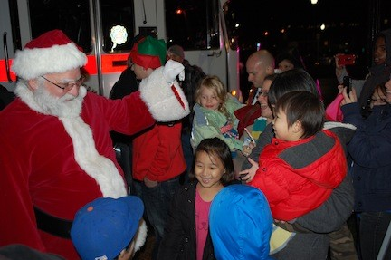 Santa Claus arrived on a Valley Stream fire truck to greet children outside of Village Hall last Friday evening.