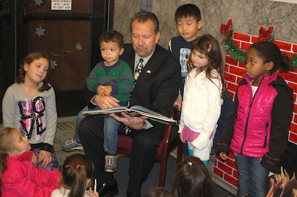 "Mayor Ed Fare read ""Twas the Night Before Christmas"" to children at Village Hall."