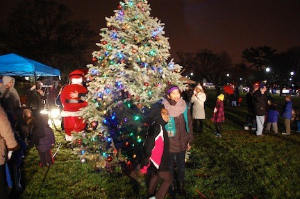 Children and Adults were excited to see the village�s new Christmas tree lit up for the first time.