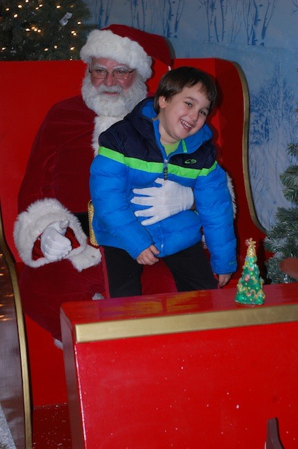 Vincent Perna, 5, got to sit with a certain seasonal celebrity at Village Hall last Friday night during Valley Stream�s tree lighting celebration.