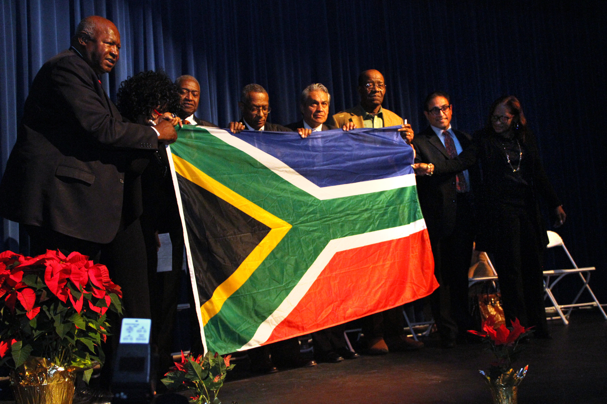 Former Hempstead Mayor James Garner, left, displayed a South African flag he said Mandela gave him. Garner was a delegate to the United Nation's 2002 World Summit on Sustainable Development in Johannesburg.