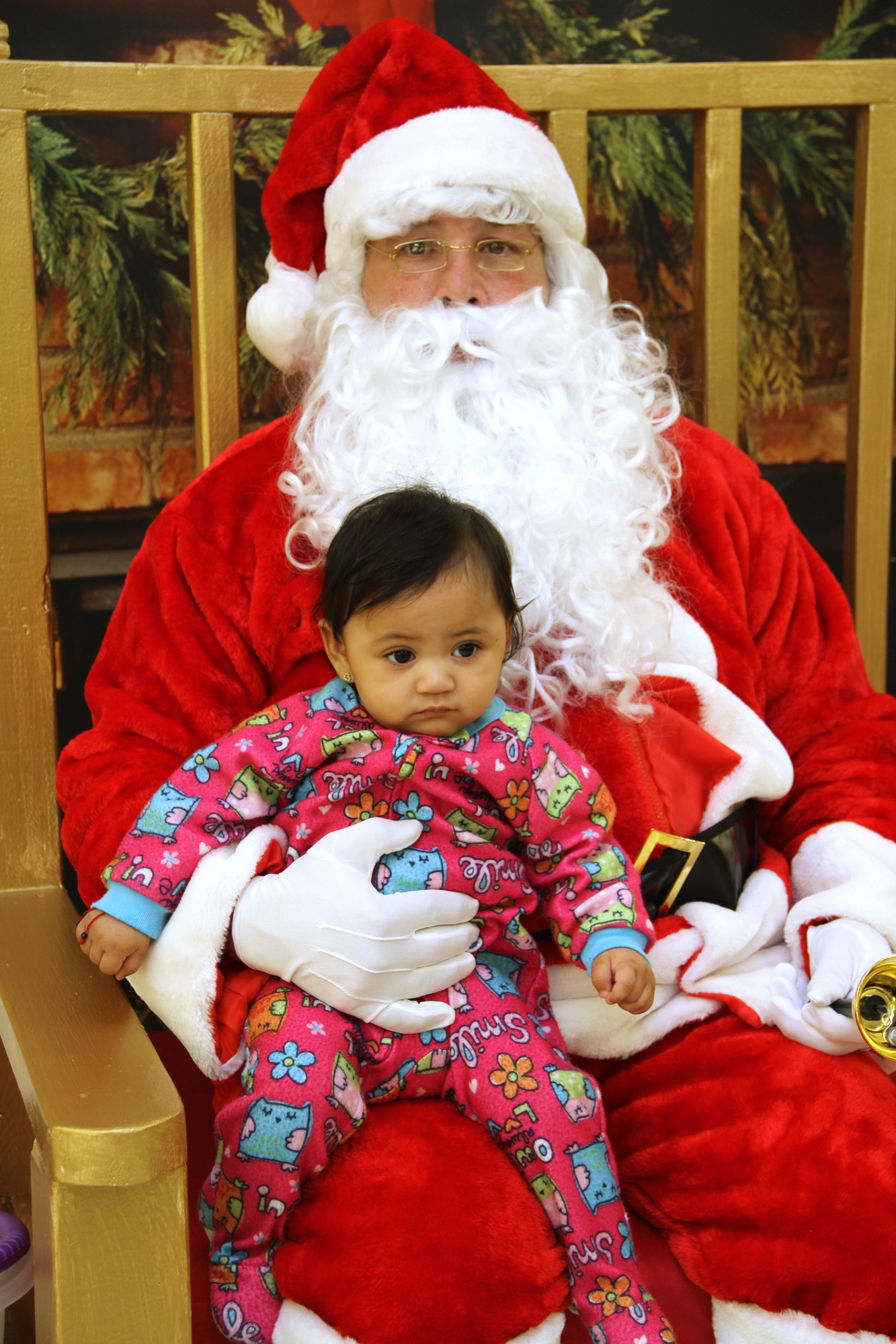 Adrianna Margolis Walker sat on Santa's lap to tell him that she was a good girl this year.