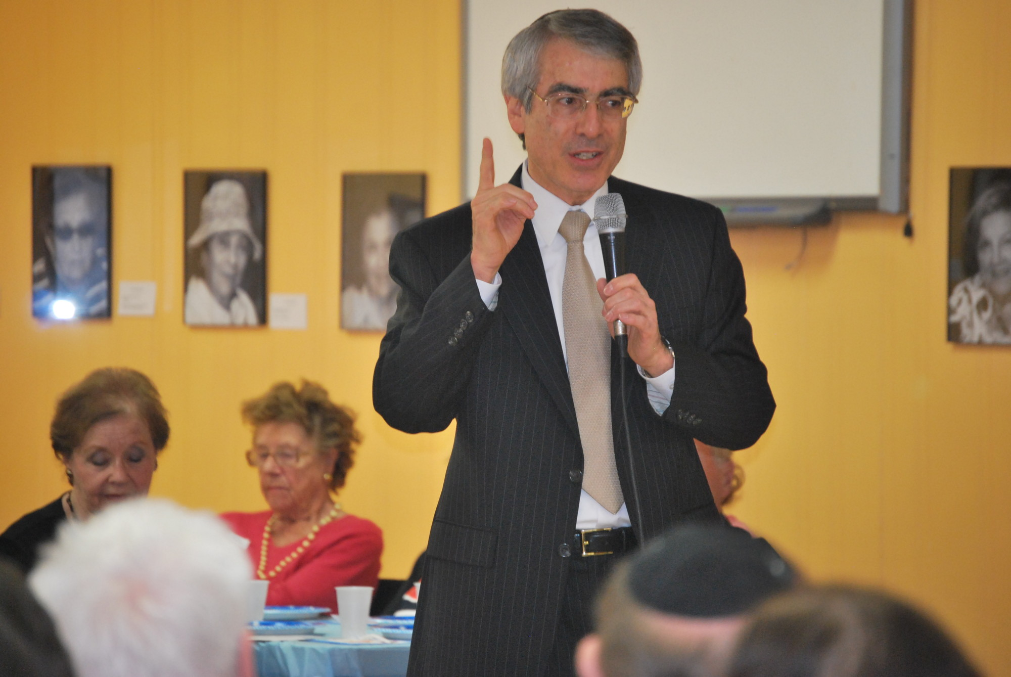 Rabbi Bruce Ginsburg of  Congregation Sons of Israel spoke to the Holocaust survivors at the JCC party.