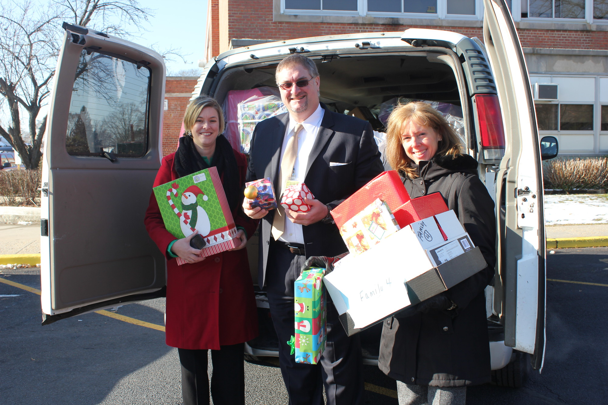Just one of the vanloads of gifts recently presented to West Hempstead High School as a result of Winthrop-University Hospital�s 2013 Adopt a Family Campaign. Matti Hasselmann, MPA, CPC, Administrative Director of the Departments of Thoracic & Cardiovascular Surgery and Orthopaedics at Winthrop, Dan Rehman, Principal at West Hempstead High Schooland Carol Giordano, Employees Activities Coordinator at Winthrop.
