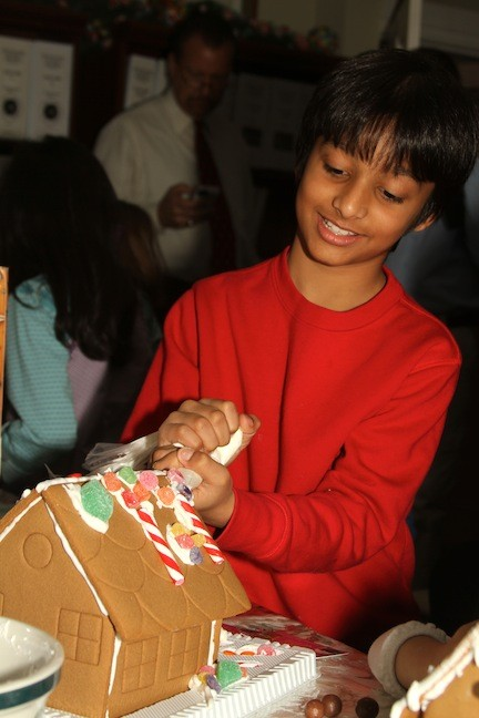 Nash Panday, 8, used the icing techniques he learned at the Pagan-Fletcher Restoration to decorate a house.