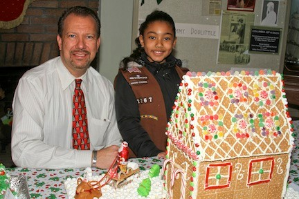 Mayor Ed Fare stopped by to see the gingerbread house entries, including the second place winner made by Kayla Larosiliere, 7, and her fellow Girl Scouts from Troop 2267.