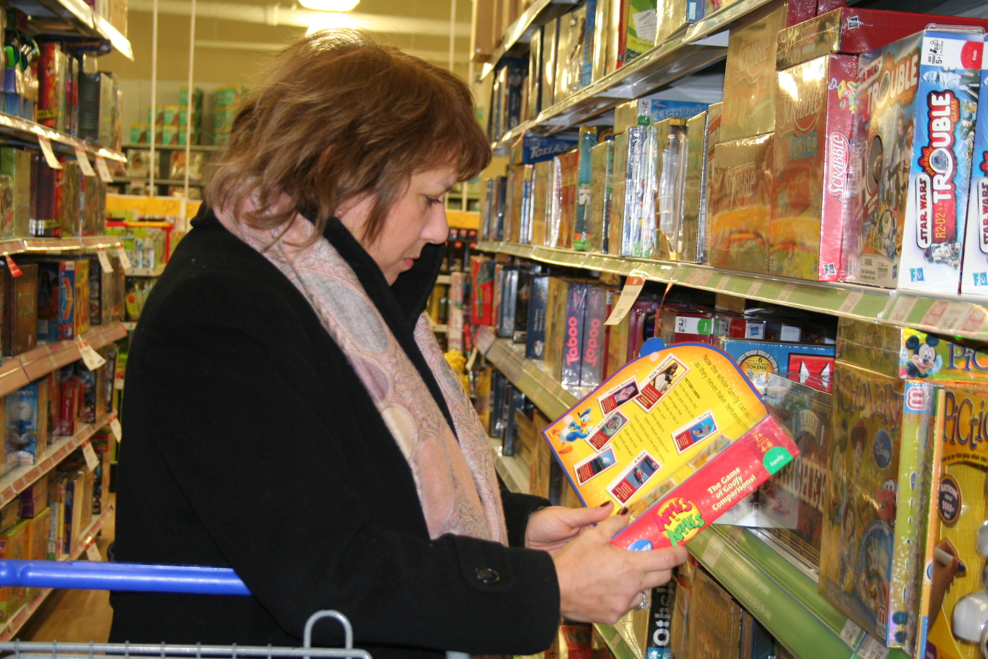 "Performing her due diligence, Number Five School social worker Robin Cutler inspected a game at Toys ""R"" Us."