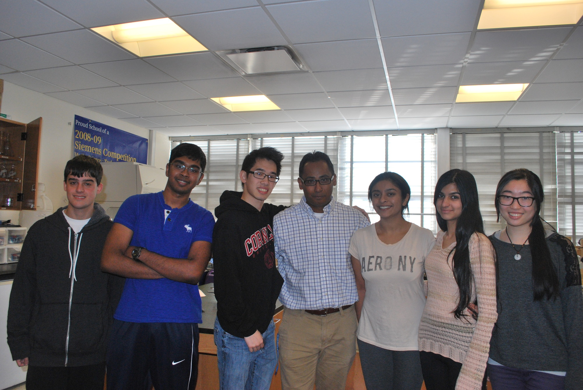 Hewlett High School's research program has generated a string of successes in prestigious science competitions, including two consecutive grand prize-winning teams. From left, the team of regional finalists, Michael Green, Ayman Haider and Stephen Ng; teacher Dr. Terence Bissoondial; and the team that won the grand prize, Priyanka Wadgaonkar, Zainab Mahmood and JiaWen Pei.