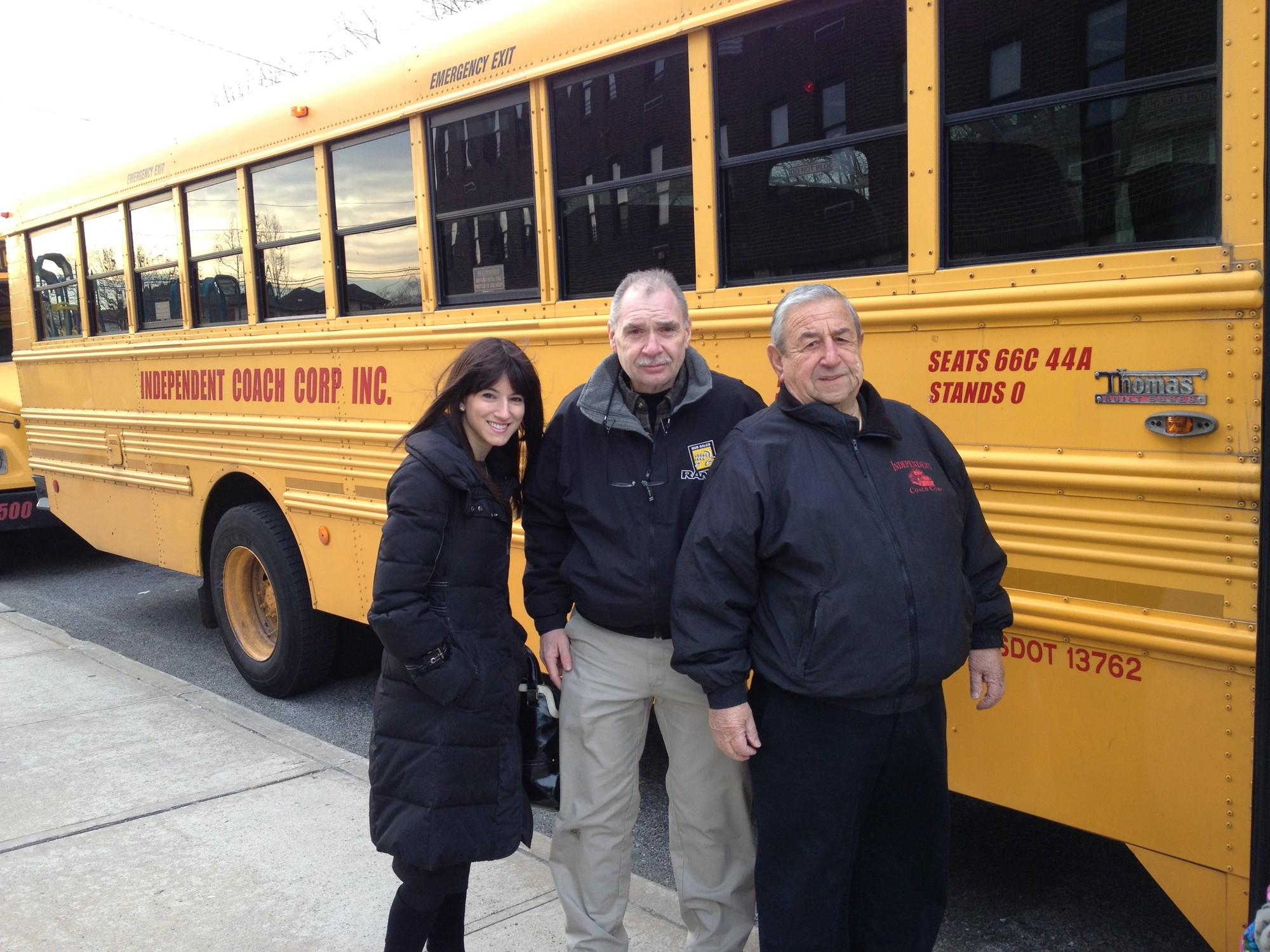 Lawrence School District added 14 buses to alleviate commuting problems for the private-school students it is responsible for transporting. From left Sara Weiss, the district's private-school transportation liaison, and Michael and Nick Fabrizio from Independent Coach.