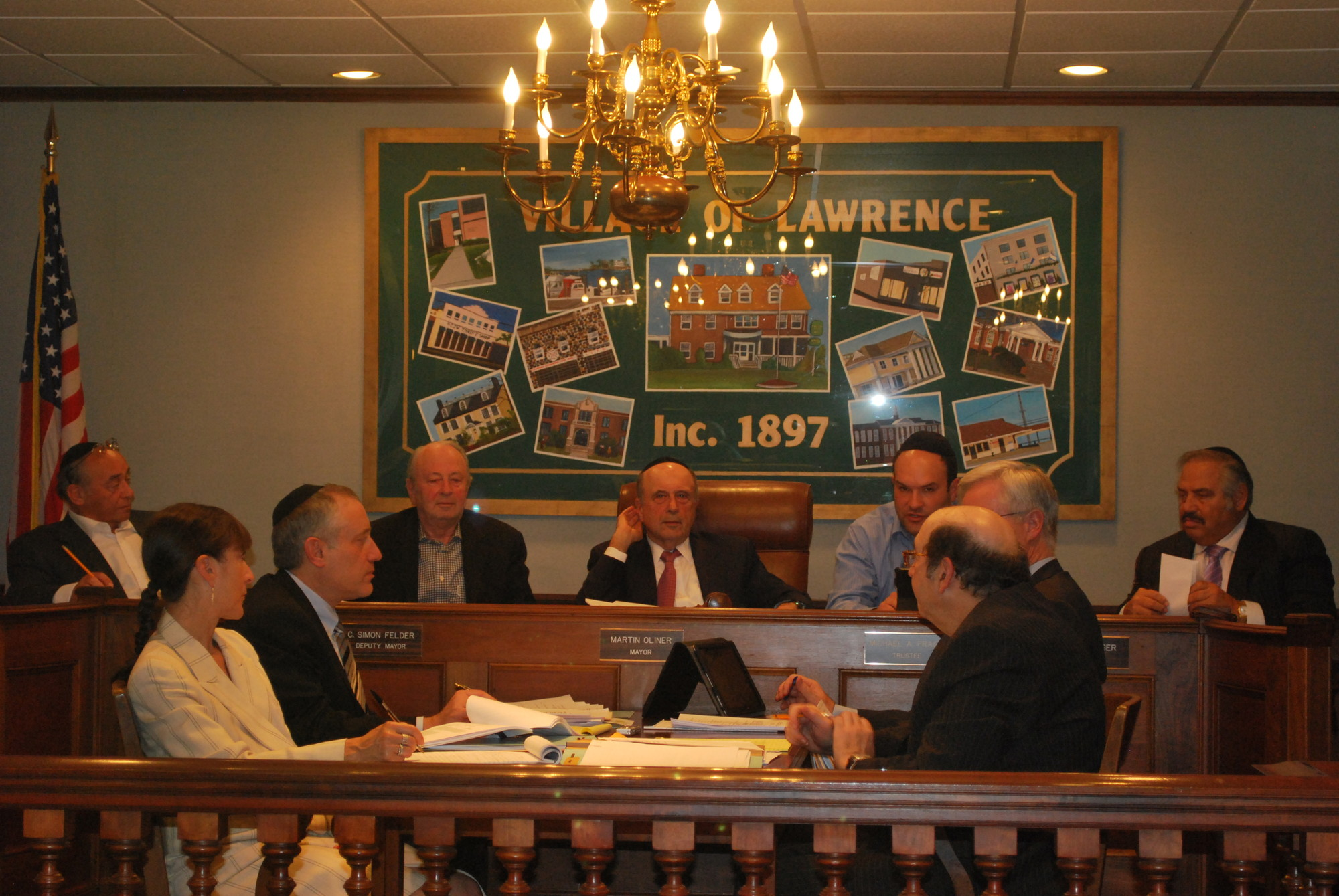 Lawrence's village board will hold a public hearing on limiting the term of trustees to six consecutive years.