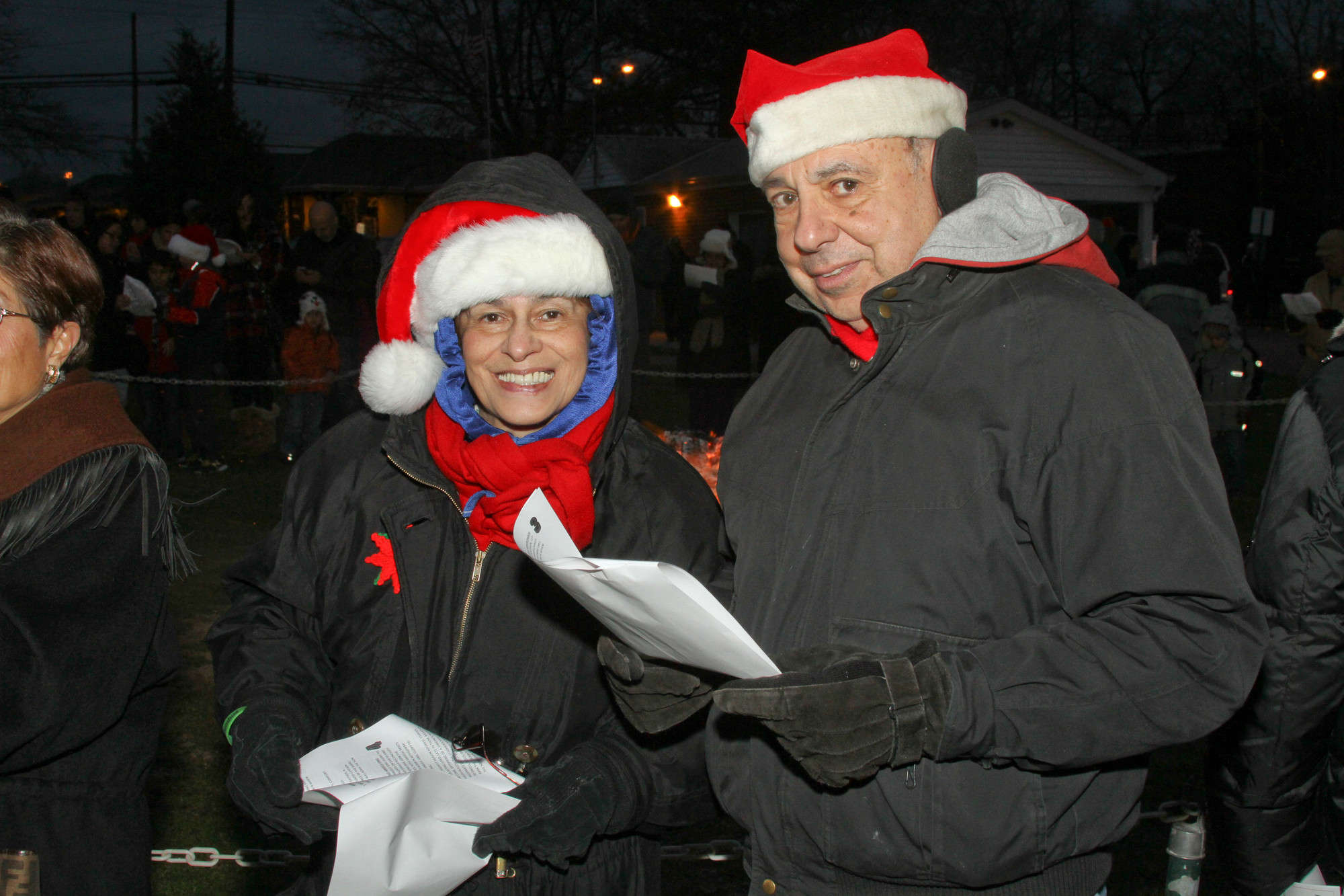 Cedarhurst's Christmas celebration in the park brought family and friends together. Gloria and Joseph Latona took part in caroling.