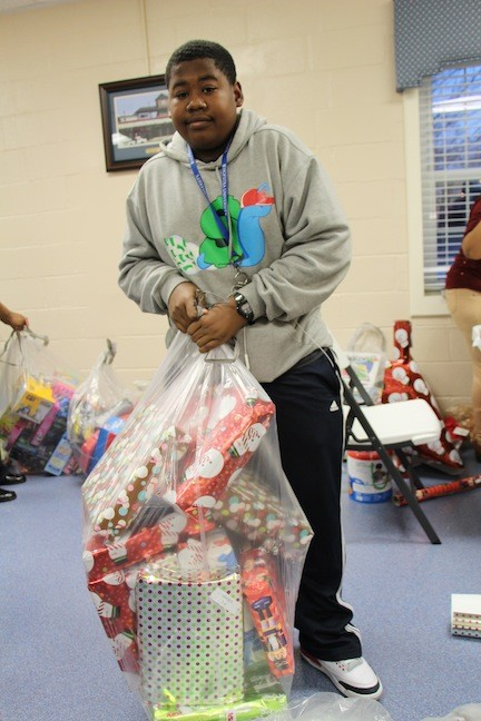 Brandon Buddoo, 15, hauled a bag full of wrapped presents, ready to be delivered to children in area homeless shelters.