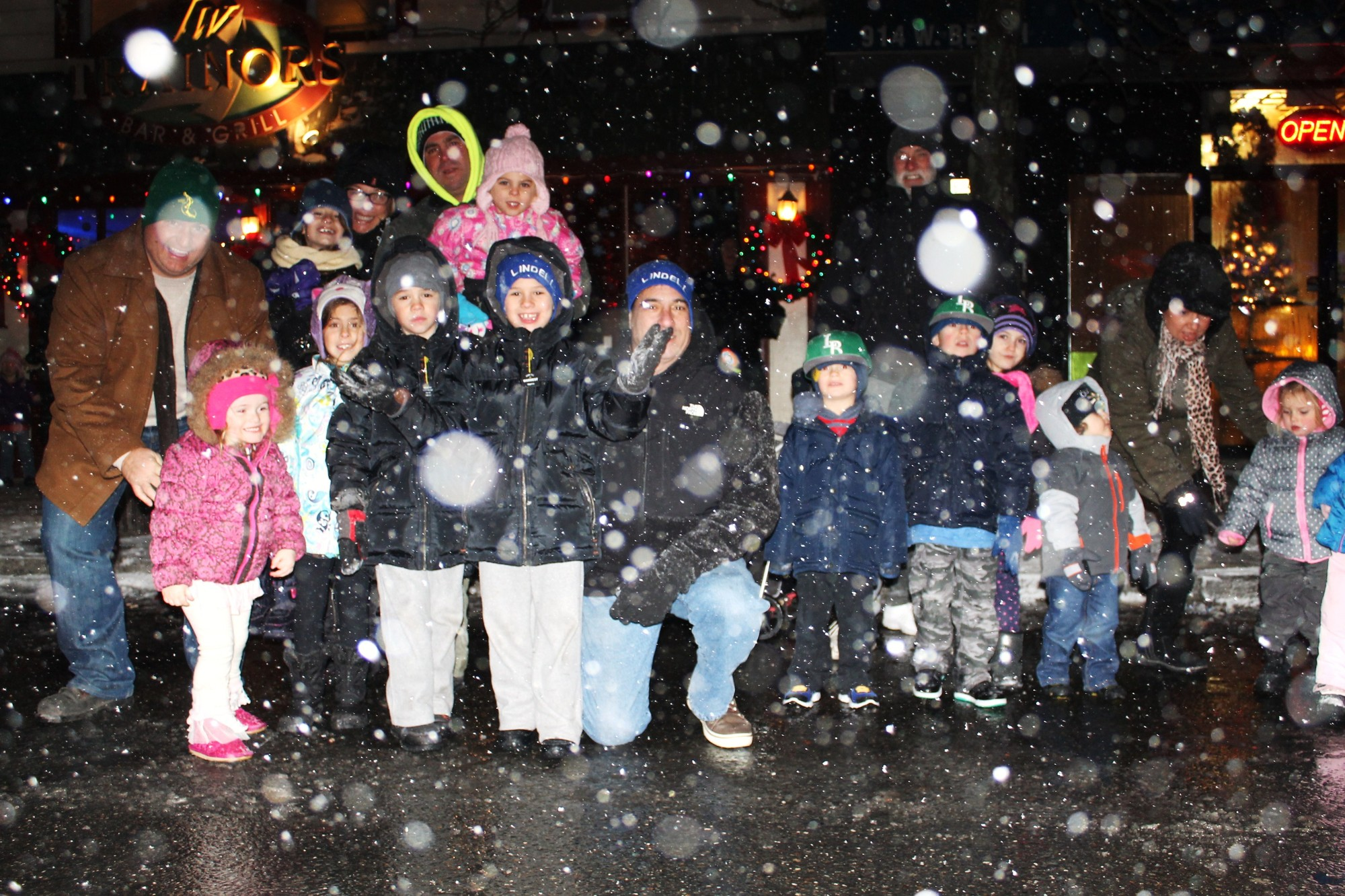 Kids bundled up and braved the snowstorm to watch the parade last Saturday.