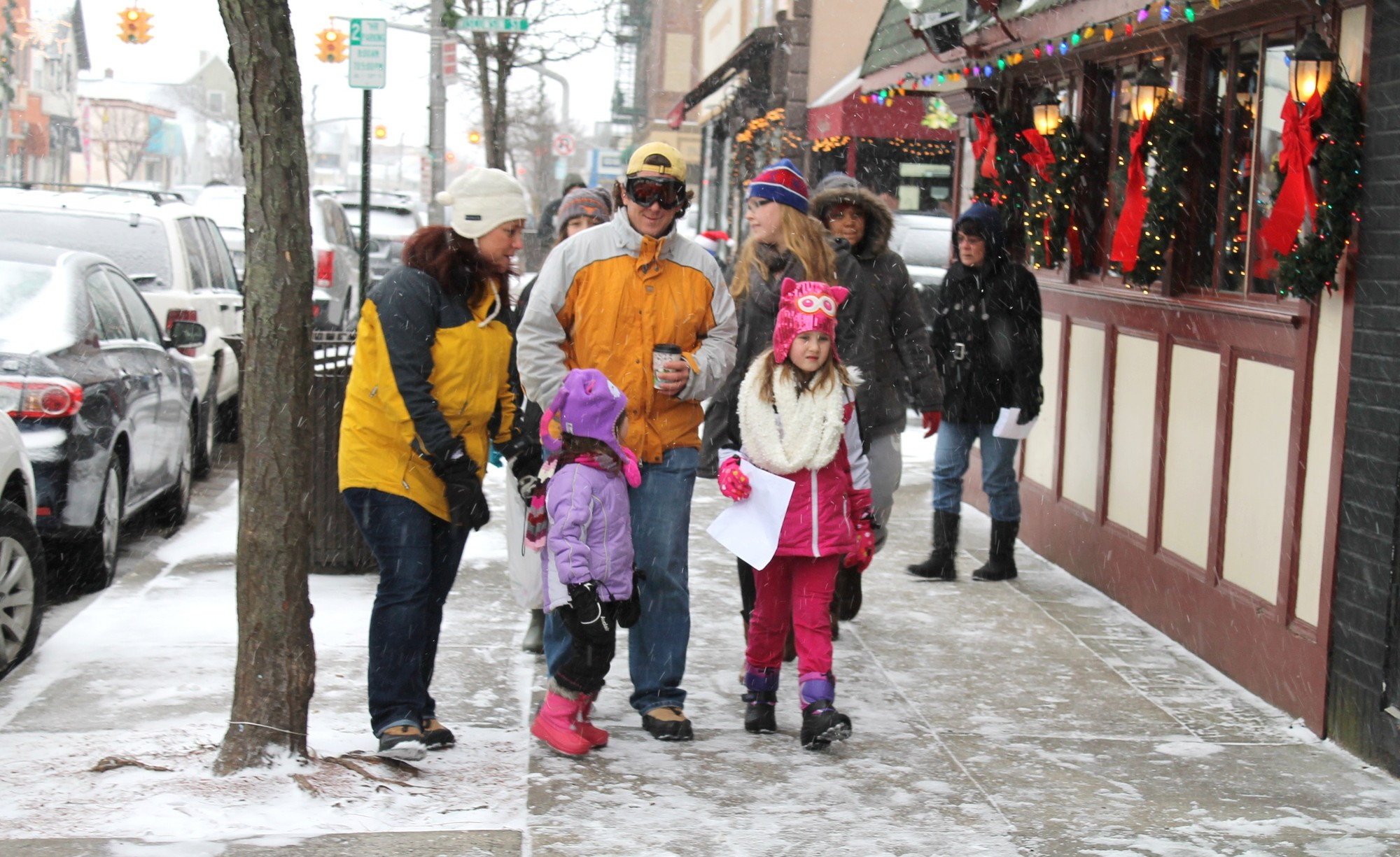 The snowstorm couldn't stop the Elf Crawl, which sent kids on a scavenger hunt through the West End.