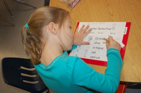 Willow Road School kindergartner Samantha Clifford works on her letter skills.