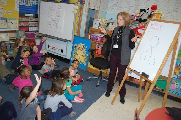 Debora O'Connor teachers her first-grade students at the James A. Dever School how to add five and seven using a number bond.