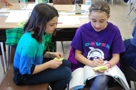 "Dever fifth-graders Angelina Somma, left, and Jenna Campo, look for metaphors in ""Esperanza Rising."""