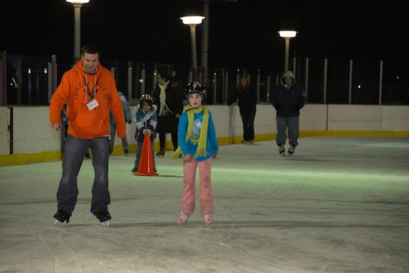 Zoe Minor, 10, escorted Herald editor Andrew Hackmack around the ice for one lap.