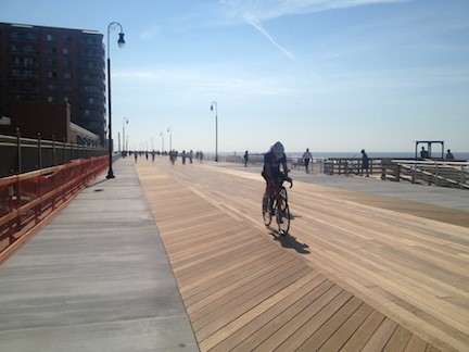 A bicyclist on a section of the new boardwalk that reopened in July. Long Beach was named among the 10 safest cities in New York state last month by Safewise, which noted the city's iconic boardwalk and other recreational activities.