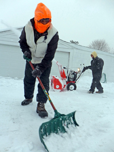 Jermaine Ewell shoveled as snow kept falling on Friday morning.