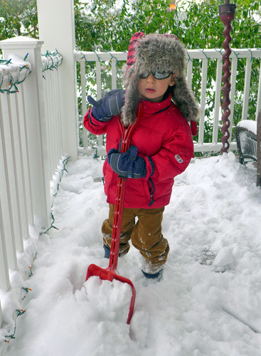 Christopher Devine, 3, of Jarvis Place in Lynbrook, helps his family clear the porch with his red shovel.
