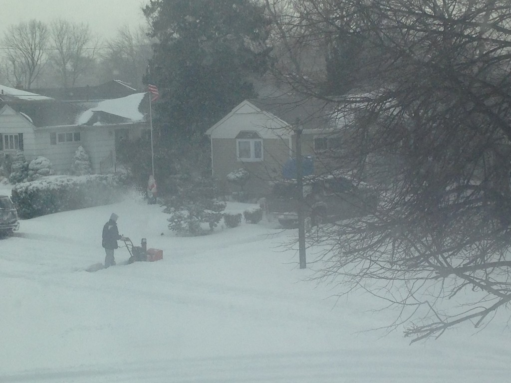 Residents, such as this one on Rutgers Road, in Franklin Square, cleared the pathways with snowblowers.