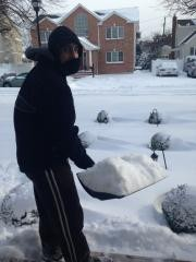Luigi Berardi braved the cold to shovel the piles of snow at his home on Rintin Street, in Franklin Square.