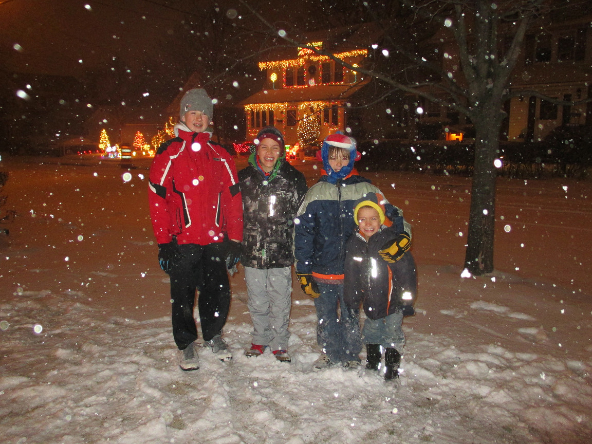 Thomas McAleer, 13, Drew Mihalick, 9, Colin McAleer, 9, and Jack Mihalick, 4, were excited to play in the snow as it was starting on Thursday night on East Maujer Street.