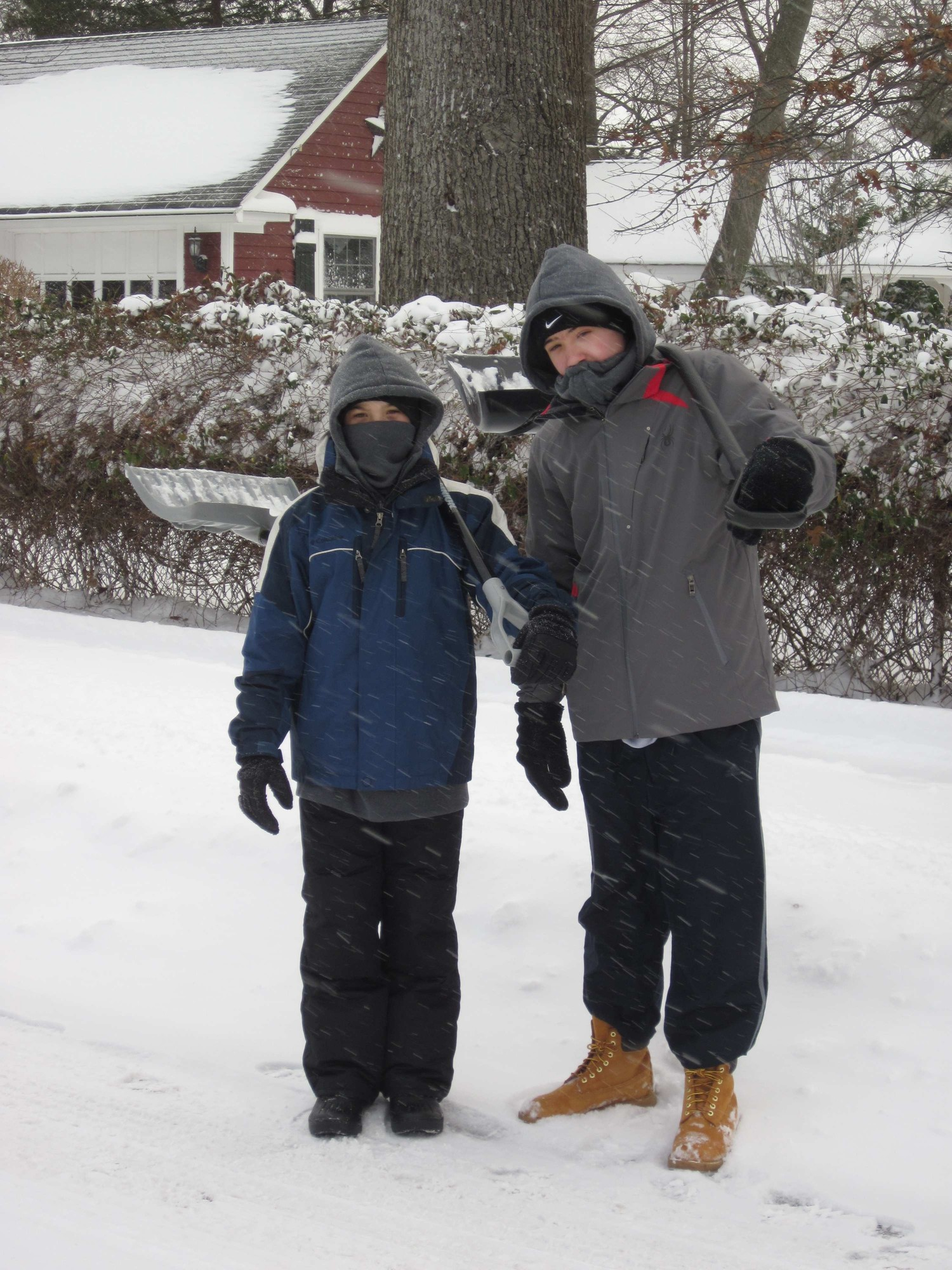 Brothers Trent, left, and Tyler Davis were starting their day by offering their help shoveling to neighbors.