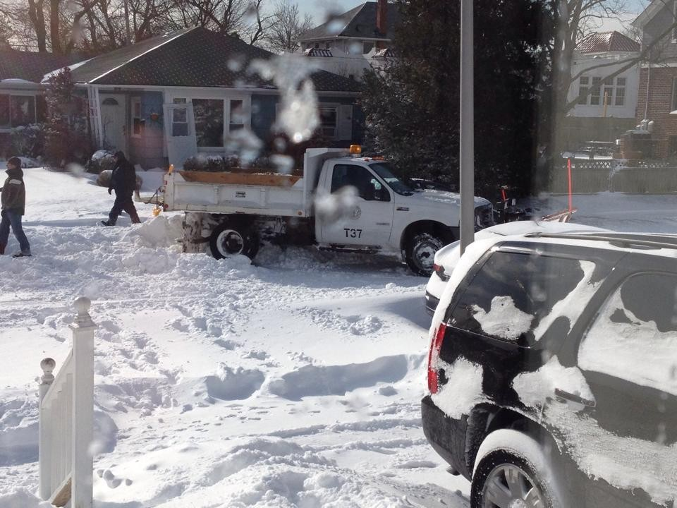 Fulton Street residents helped dig out a a snowplow that got stuck.