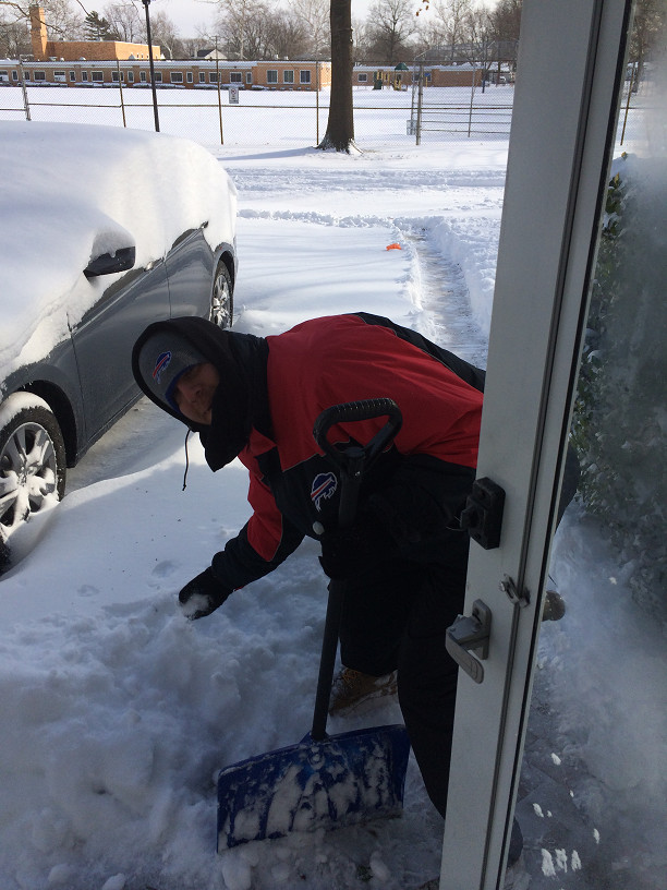 Kenny Tenzer came in from the city to help his parents shovel out their Jasmine Lane home in Mill Brook.