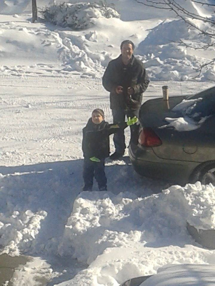John Healy and his son, John, 6, enjoyed about 10 minutes together outside in the snow.