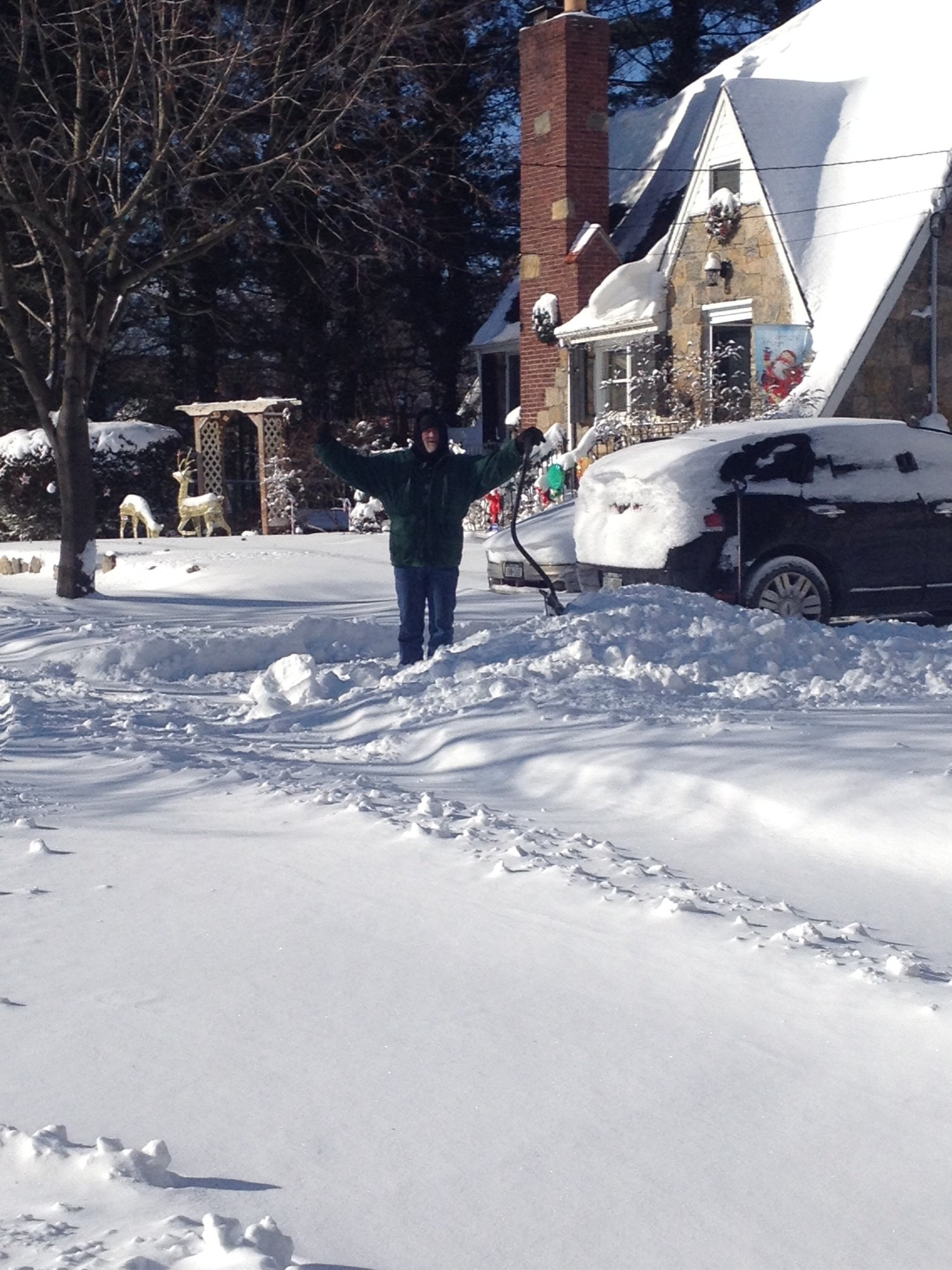 Wayne Smith kept his spirits high while digging snow out of his driveway on Arthur Street in Seaford.