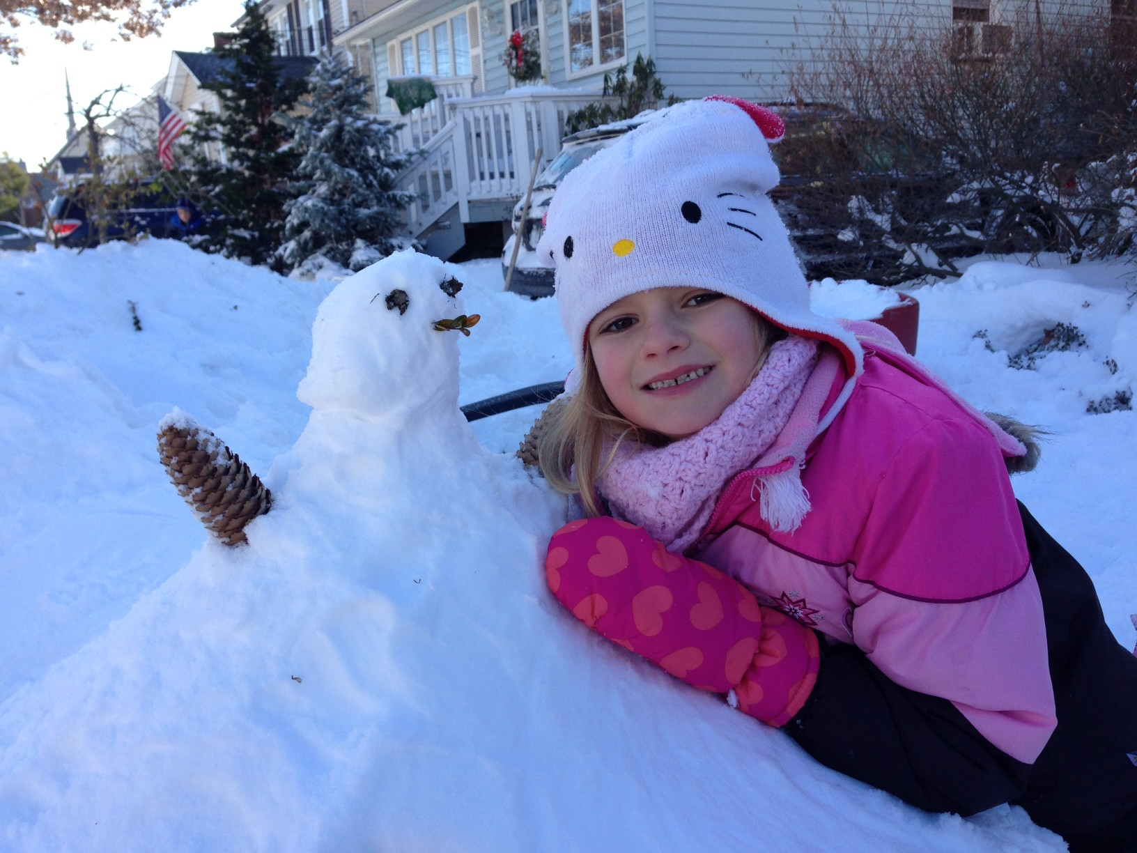 Hannah Wallach, 6, of Gibson, made a snow girl with her Locust Street neighbors.