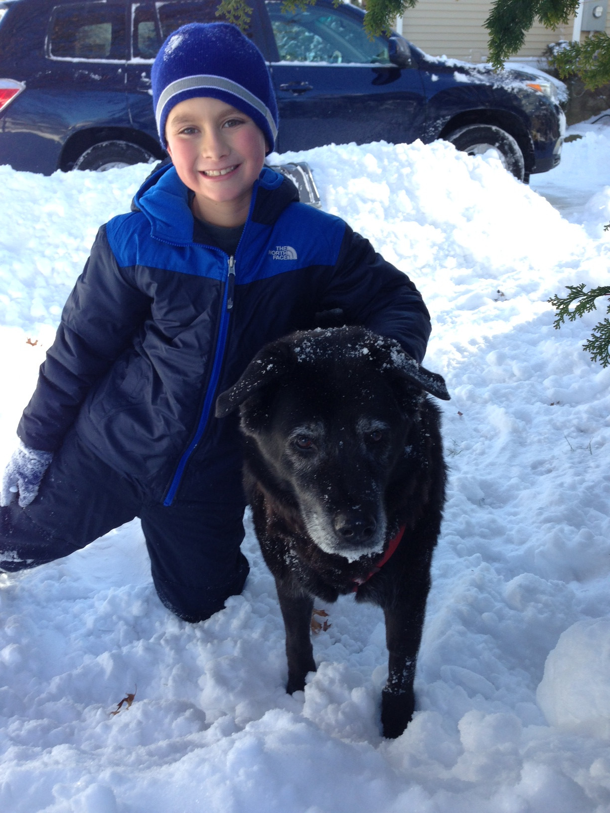Matthew Wallach, 9, enjoyed some time in the snow with his dog, Samantha, after getting the shoveling done.